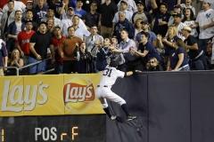 New York Yankee Ichiro Suzuki Climbs the Wall